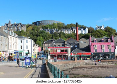SCOTLAND, ARGYLL AND BUTE, OBAN - OCTOBER 12, 2015: City view of Oban with Oban Distillery and McCaig's Tower