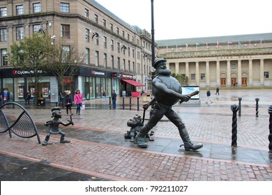 SCOTLAND, DUNDEE, HIGH STREET - OCTOBER 16, 2014: Desperate Dan and Minnie the Minx Statue in the City Centre of Dundee in Scotland