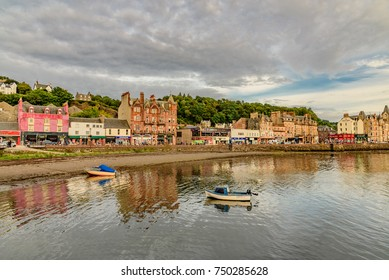 SCOTLAND, ENGLAND - AUGUST 13, 2017 -  sunset on the fishing town Oban famous for whiskey distilleries in Scotland in England
