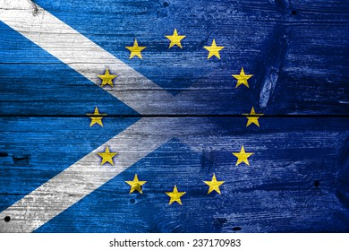Scotland and European Union Flag painted on old wood plank texture