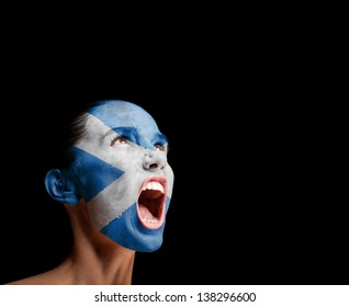The Scotland flag on the face of a screaming woman. concept