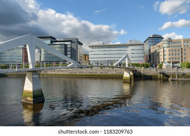 SCOTLAND - GLASGOW, JULY 21, 2017:  The Tradeston Bridge, also know as the Squiggly Bridge crosses the river Clyde connecting theAnderston and Tradeston districts of Glasgow.