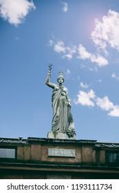 Scotland, Glasgow, Merchant City, the Italian Centre - SEPT. 2018. 26: Italia statue on the facade of the Italian Centre in Ingram Street