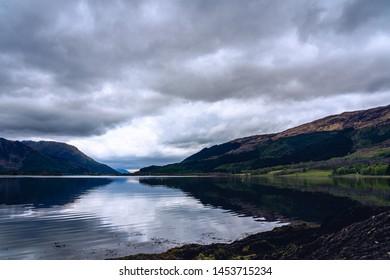Scotland Highland valley mountain water foreground low angle Glen Etive Glen Coe