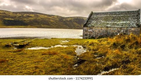 Scotland landscape. A boathouse at the edge of Loch Muick. Royal Deeside. Cairngorms National Park, Aberdeenshire, Scotland, UK.