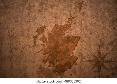 scotland map on a old vintage crack paper background