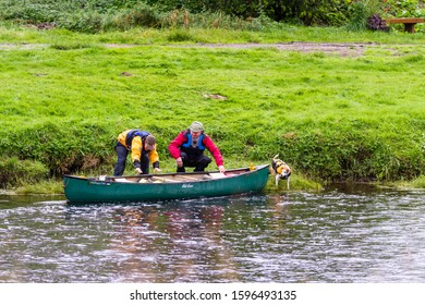 Scotland  - September 08 2019: Couple and their dog getting into a canoe in the Spay river near Grantown, UK September 08,  2019