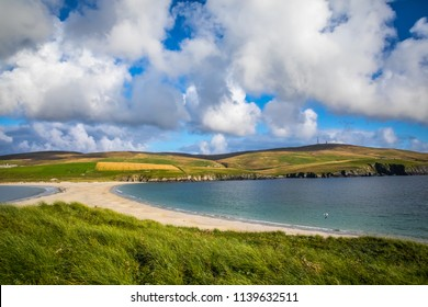 Scotland, Shetland Islands, St Ninian's Beach, A tombolo is a deposition landform in which an island is attached to the mainland by a narrow piece of land such as a spit or bar.