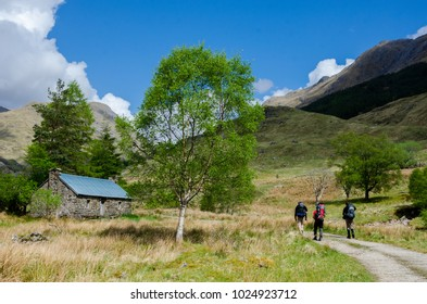 SCOTLAND, UNITED KINGDOM - MAY 14, 2017: Hiker approching mountain shelter, the Cape Wrath Trail , Scottish Highlands.