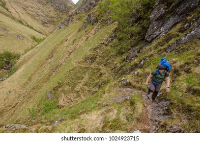 SCOTLAND, UNITED KINGDOM - MAY 18, 2017: Trekkers hiking on  the Cape Wrath Trail in Scottish Highlands.