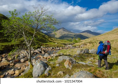 SCOTLAND, UNITED KINGDOM - MAY, 2017 : Trekkers hiking on  the Cape Wrath Trail in Scottish Highlands.