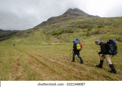 SCOTLAND, UNITED KINGDOM - MAY, 2017 - Trekkers hiking on  the Cape Wrath Trail in Scottish Highlands.