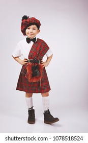 A scotsman boy in a kilt, a Scottish national costume