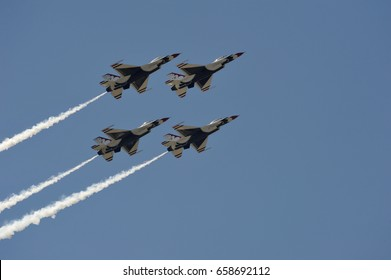 SCOTT AIR FORCE BASE, IL, UNITED STATES - June 10, 2017: Air Force pilots perform maneuvers in an air show during the Scott Air Force Base Centennial Celebration on June 10, 2017.