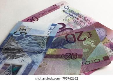 Scottish banknotes on white background.