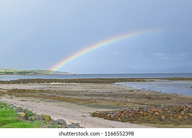 Scottish Beach Landscape With Rainbow - boat in Foreground