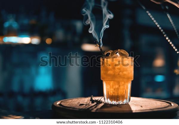 Scottish Bee Cocktail Smoke On Blue Stock Photo (Edit Now