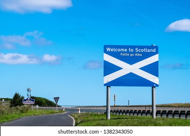 Scottish Borders, Scotland-England national border, Britain, July 2016, Welcome to Scotland flag sign at border also written in Gaelic language