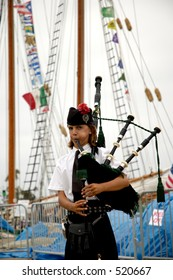 Scottish boy playing the bagpipes at the Tall Ships L.A. event in San Pedro Harbor, California.