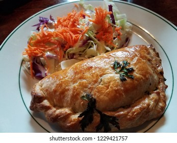 Scottish food baked meat pie with carrot salad