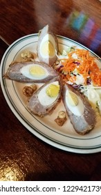 Scottish food sausage meat with eggs and carrot salad