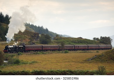 SCOTTISH HIGHLANDS, SCOTLAND â?? AUGUST 14: The Jacobite steam train travelling through the Scottish Highlands, between Fort William and Mallaig on August 14, 2014