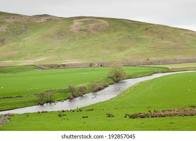 Scottish landscape with beautiful green field and river Clyde