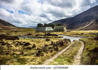 Scottish landscape in Cairngorms and house in the mountains. Path from Invermark to Mount Keen. Angus, Aberdeenshire, Scotland, UK. April 2018