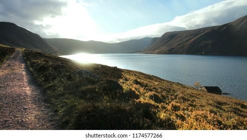 Scottish landscape panorama. Loch Muick in Cairngorms National Park. Royal Deeside, Ballater, Aberdeenshire, Scotland, United Kingdom.