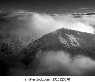 Scottish mountains in the clouds in winter.