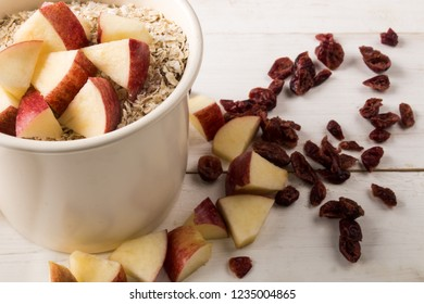 scottish oatmeal in a mug with apple and dried cranberry