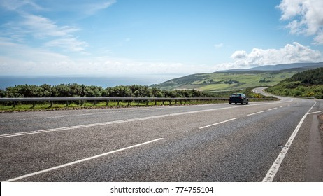 Scottish road trip. A view south along the arterial A9 road north of Helmsdale in the north east of Scotland. The road is one of the most northerly A roads on the British mainland. - Shutterstock ID 774755104