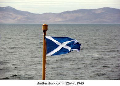 Scottish Saltire flag blowing in the breeze on board ferry to Isle of Islay, Inner Hebrides, Scotland.