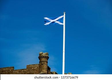 Scottish Saltire flag on flagpole at a Scottish castle
