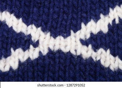 The Scottish St Andrew's Cross (saltire) hand knitted into a garment