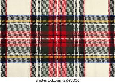 Scottish tartan pattern. Red and white wool plaid print as background. Symmetric square pattern.