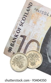 Scottish Ten Pound Note With A Two Pound Coins With Scottish Thistle Design On The Coins