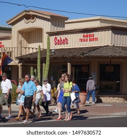 Scottsdale, Arizona / USA - February 12, 2016:  Tourists cross intersection of old Scottsdale in shopping area.