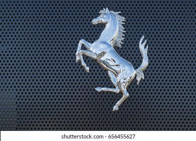 Scottsdale, Arizona, USA - July 07, 2017: Ferrari horse logo. Ferrari N.V. is an Italian sports car manufacturer based in Maranello. Founded by Enzo Ferrari in 1939.