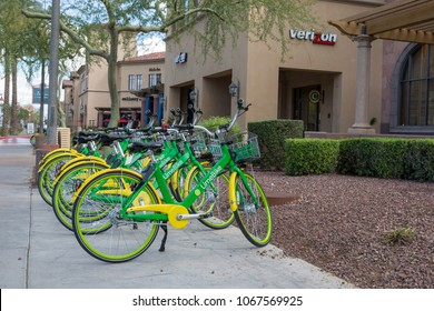 SCOTTSDALE, ARIZONA USA - MARCH 11, 2018: Community Rental Bicycles for Public use Using a Smart Phone App Available on a sidewalk in Scottsdale, Arizona USA.
