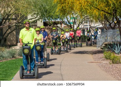 SCOTTSDALE, ARIZONA USA - MARCH 11, 2018: Tourists with guide on Segway scooters touring downtown Scottsdale Arizona USA on a nice spring day.
