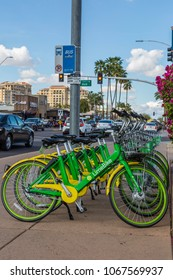 SCOTTSDALE, ARIZONA USA - MARCH 11, 2018: Community Rental Bicycles for Public use Using a Smart Phone App Available strategically placed near a bus stop on a sidewalk in Scottsdale, Arizona USA.