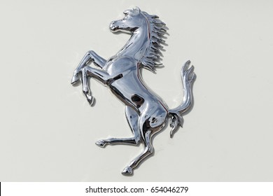 Scottsdale, Arizona, USA - May 31, 2017: Ferrari horse logo on Ferrari F12 Berlinetta. Ferrari N.V. is an Italian sports car manufacturer based in Maranello. Founded by Enzo Ferrari in 1939.