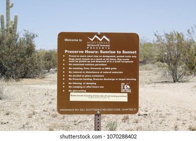 SCOTTSDALE, AZ - APRIL 3: The City of Scottsdale's McDowell Sonoran Preserve hours, rules, and regulations sign posted at Brown's Ranch public park in Scottsdale, Arizona on April 3, 2018.