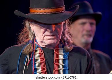 SCOTTSDALE, AZ - JANUARY 15: Country music legend Willie Nelson performs at the Childhelp Drive the Dream gala on January 15, 2011 in Scottsdale, Arizona.