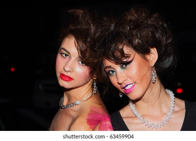 SCOTTSDALE, AZ - OCTOBER 7: fashion week models greet guests on the pink carpet for the start of the Phoenix Fashion Week runway shows on October 7, 2010 in Scottsdale, AZ.