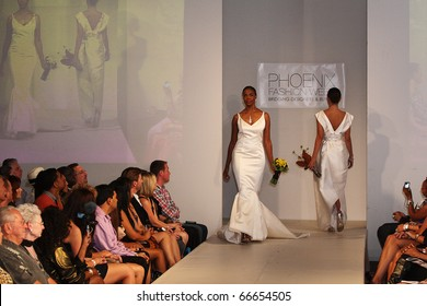 SCOTTSDALE, AZ - OCTOBER 9: Models showcasing designs from the SJ Couture Wedding gown collection at the Phoenix Fashion Week runway shows on October 9, 2010 in Scottsdale, AZ.
