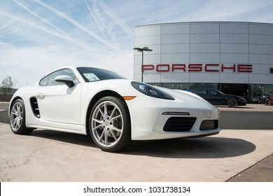 Scottsdale, AZ, USA - 17 February 2018: Porsche 718 Cayman model 2018 in front of Porshe store. Porsche AG is a German automobile manufacturer specializing in high-performance sports vehicles.