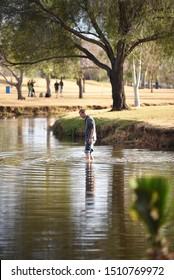 Scottsdale  AZ/USA 01/10/2018 man  waiting into a pond in a park in Scottsdale Arizona