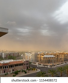 Scottsdale,Az/USA -7.30.18: Monsoon storm hits the valley area with a wall of dust, high winds and 4,000 lightning strikes at it's peak.  Wood is scene dangerously falling from new construction.